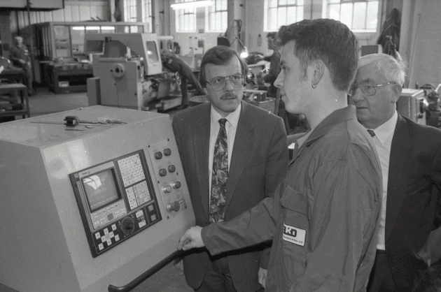 David Porter speaks to apprentice Mathew Owen on his visit to the Machine Shop back in 1993. Picture: Archant